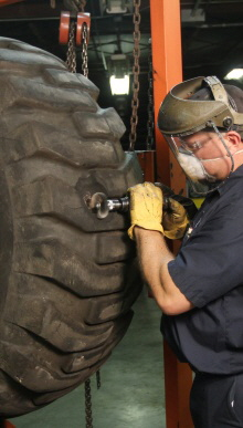 Experienced OTR tire repair technicians can repair damage in our Graham location